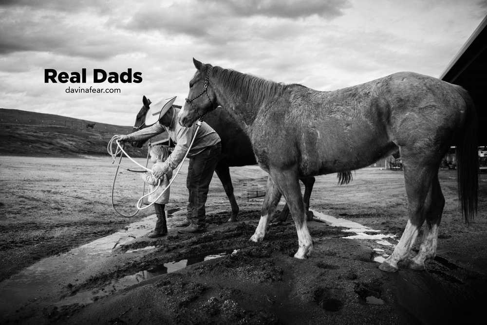 real dad with daughter leading a horse